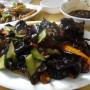12) champignons noirs en sauce